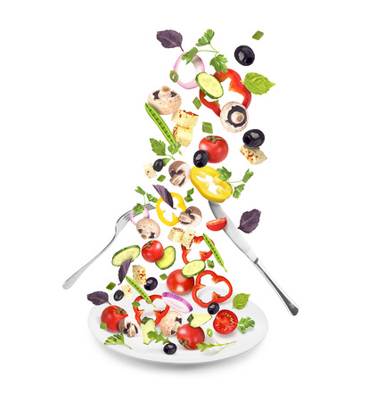plate with salad, knife and fork isolated on white background