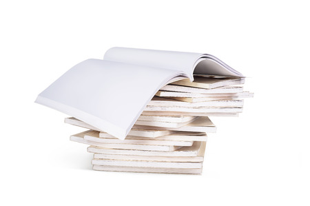 pile of books with an open book on top, isolated on a white background Stock Photo