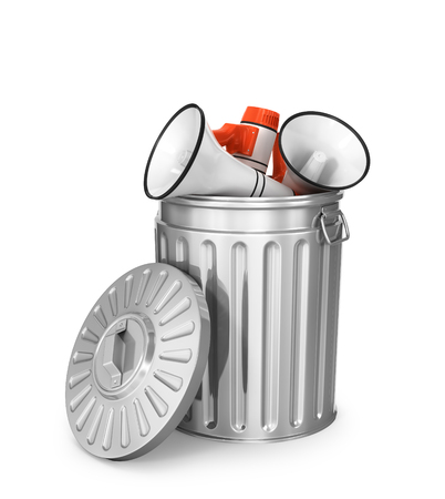 Concept of propaganda. Yellow press. Megaphones in the trash can on a white background. 3d illustration