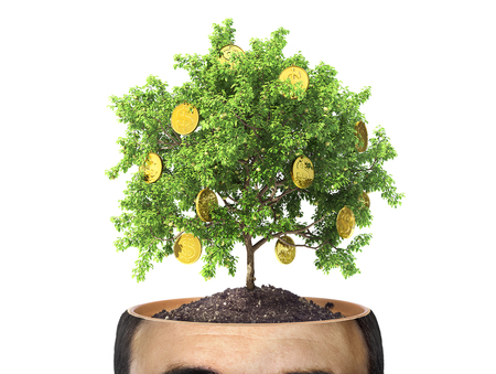 Concept of striving for wealth. Money tree in the cut of head on the white background. Greed. Stock Photo