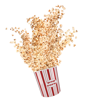 Popcorn flies out of a paper cup