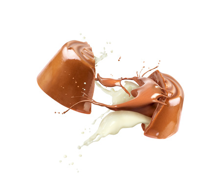 Chocolate candy, split in half, with chocolate and dairy flow, isolated on white background Foto de archivo