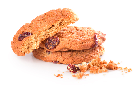 Broken biscuit with crumbs on white background