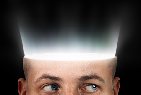 From the slice of the head shines a light on a black background