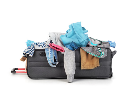 Open suitcase with clothing isolated on a white Archivio Fotografico