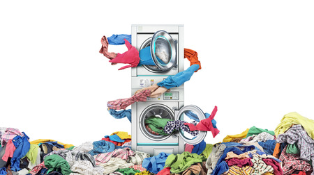 Clothes fly out of a washing machine into a tumble dryer Standard-Bild