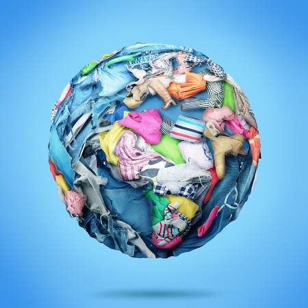 Planet made of clothes on a blue background. Donation.
