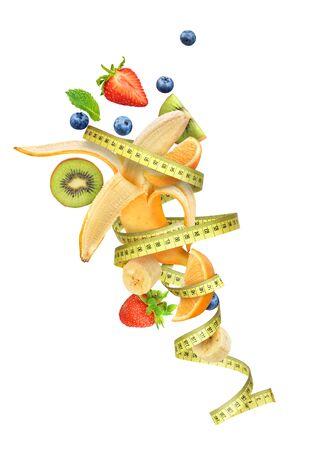 measuring tape wrapped around fruit