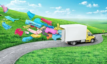 The concept of moving. A cargo van rides along the road and clothes fly out of it on a beautiful nature background. Delivery concept.