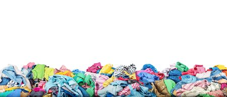 Concept of sale. Big pile of clothes on a white background. Donation