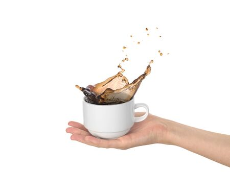 white cup with coffee splas  in the womens hand isolated