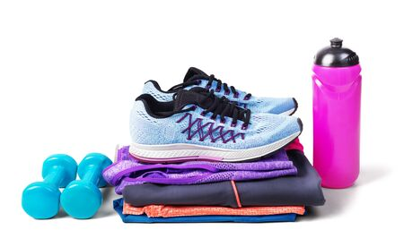 Set of women's clothing and workout accessories for fitness isolated on white background
