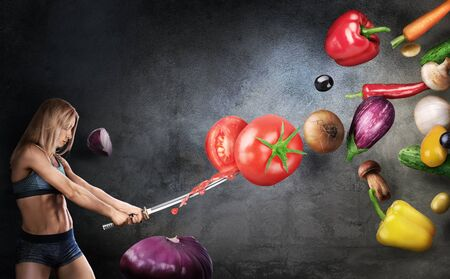 Healthy eating concept. Young fitness girl cuts flying vegetables with a Japanese sword on a dark background. Cooking concept.