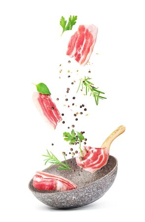 Cooking concept. Vegetables and bacon are falling on a pan isolated on white background. Healthy food. Stok Fotoğraf - 131244186