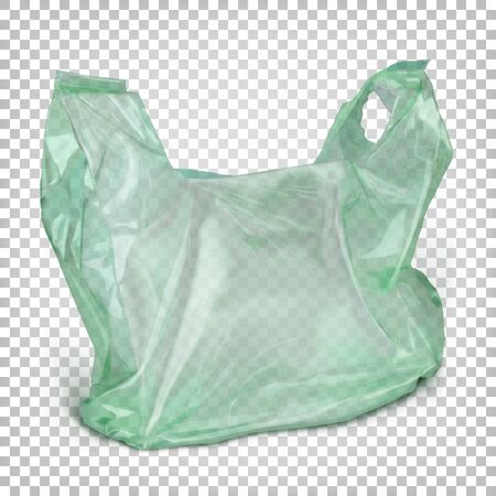 Transparent green polythene  bag with handles standing on the surface.