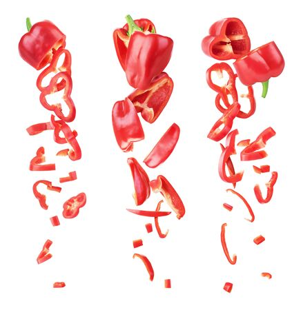 Sweet red pepper sliced and falling isolated on a white background