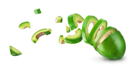 Avocado sliced and falling isolated on a white background