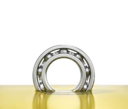 Oiling bearing. Bearing in oil isolated on a white background. 3d illustration