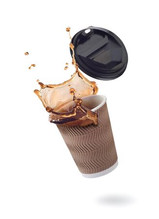 Splash of coffee in a paper cup on a white