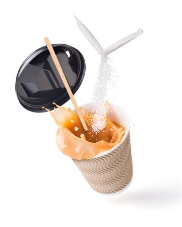 splash of coffee with milk in a paper cup with a broken stick of sugar Stok Fotoğraf