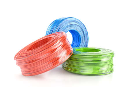 Color cable coils on white Foto de archivo