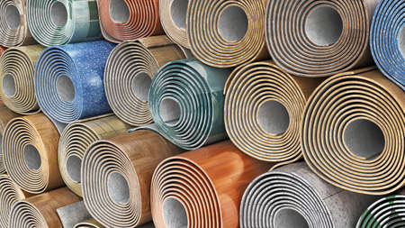 Linoleum rolls in different color schemes stacked one on another, 3d illustration Banque d'images - 167164800