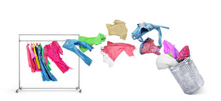 The concept of moving and transporting clothes. Clothes fly off a hanger and fly into a cardboard box isolated on white background