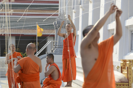year's eve: Monks in the preparations for the New Year s Eve celebration in the temple complex of Wat Pho in Bangkok, capital of Thailand in South East Asia