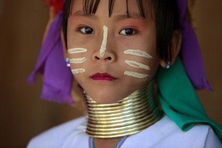 A traditionally dressed wife of a long-necked Paudang tribe from Burma living in a village north of Chiang Mai in northern Thailand