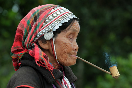 traditionally: Traditionally dressed woman from a tribe of Akha village when fishing north of Chiang Mai in northern Thailand