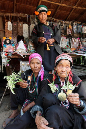 traditionally: Traditionally dressed women of a tribe of Akha village when fishing north of Chiang Mai in northern Thailand Editorial