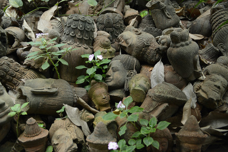Traditional figures, in the garden of Ban Phor Linag Meuns Terracota type ready for sale in Terracota Garden in Chiang Mai in the north of Thailand in South East Asia photo