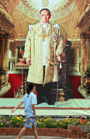 bhumibol: A large picture of the king Bhumipol Adulyadej Rama 9 in the temple complex of Wat Phra That Doi Suthep in Chiang Mai in Chiang Mai province in northern Thailand in Southeast Asia Editorial