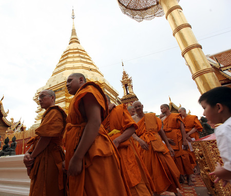 A monk in the temple complex of Wat Phra That Doi Suthep in Chiang Mai in Chiang Mai province in northern Thailand in Southeast Asia
