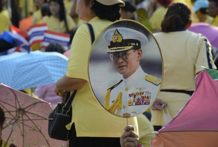 bhumibol: Thousands of Thai people celebrate the coronation of King Bhumibol on the Sanam Luang park in front of Wat Phra Kaew in Bangkok City in Thailand in Southeast Asia