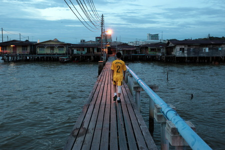 stilt house: A taxi boat at night in the town of Kampung Ayer stilt house in the center of the capital Bandar Seri Begawan in Brunei Darussalam Kingdom on Borneo in South East Asia Editorial