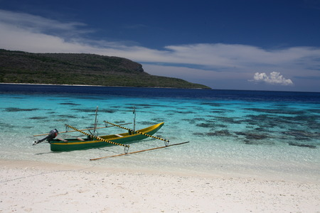The beach scenery on the Jaco Island in the background in the most eastern point on the Timor Sea in East Timor on the island of Timor separated into two in Asia