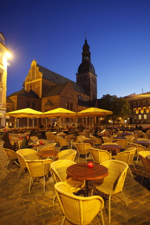 Europe, Eastern Europe, Baltic States, Latvia, Riga, capital city, Old Town, Cathedral Square, Cathedral, bell tower, restaurant, evening, a restaurant and beer house in front of the cathedral at the Cathedral Square in Old Riga, capital of Latvia in the  Editorial