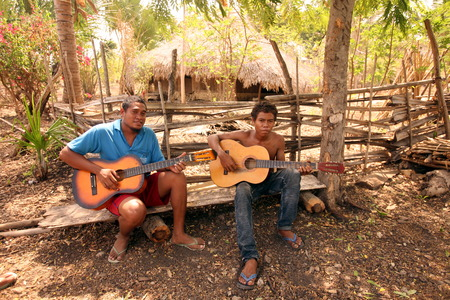 Two Musicians at Venilale in East Timor on the Zental in two separate island of Timor in Asia