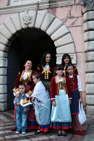 balkans: Costume people in the Old town of Kotor on the Mediterranean Sea in Montenegro in the Balkans in Europe