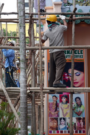 restoring:  Indians while restoring an Indian temple in Singapore in Southeast Asia Editorial