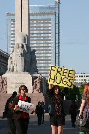 an action for a free hug in front of the Monument of Freedom in the New Town of Riga, capital of Latvia in the Baltic States and Eastern Europe