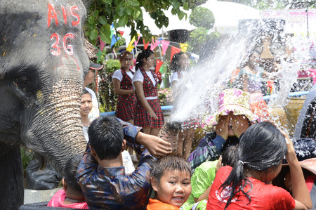 The Songkran festival or Thai New Year water festival to be in full swing north of Bangkok in Ayutthaya Thailand in South East Asia