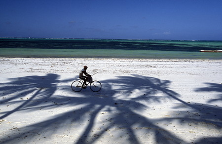 The sandy beach at Bwejuu on the east coast of Zanzibar Island in the Indian Ocean in Tanzania in East Africa