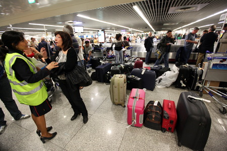 Chaos for air shifts and Flugausfaellen in Reisegepaeck lobby at the International Airport of Lisbon in Portugal