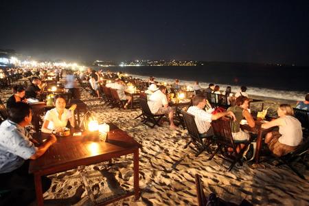 Jimbaran Beach with a seafood restaurant on bali in indonesia Editorial