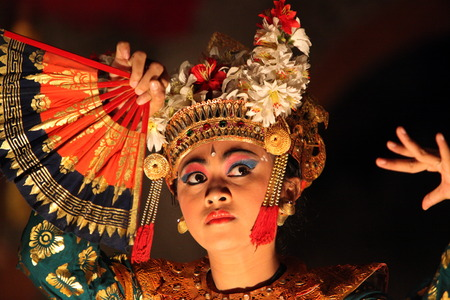A dancer at a traditional Balinese Tanzauffuehrung in Ubud in Central Bali on the island of Bali in Indonesia