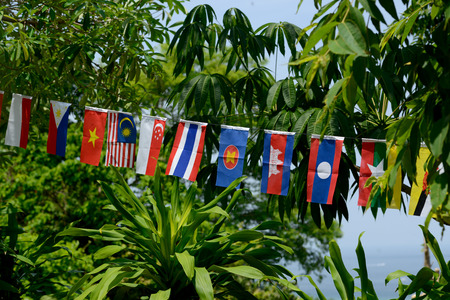 ferien: Flags of the ASEAN Nations in the Town of Ko PhiPhi on Ko Phi Phi Island outside of the City of Krabi on the Andaman Sea in the south of Thailand.