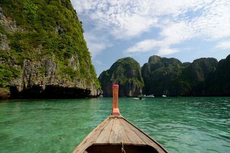 sued: a Boat on the way to Maya Beach  near the Ko Phi Phi Island outside of the City of Krabi on the Andaman Sea in the south of Thailand.  Stock Photo