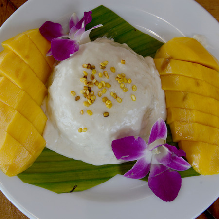 phra nang: a Thai desert rice with mango in a restaurant at the Hat Railay Leh Beach at Railay near Ao Nang outside of the City of Krabi on the Andaman Sea in the south of Thailand.